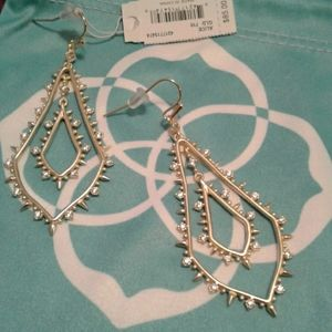 A set of earrings in gold from Kendra Scott